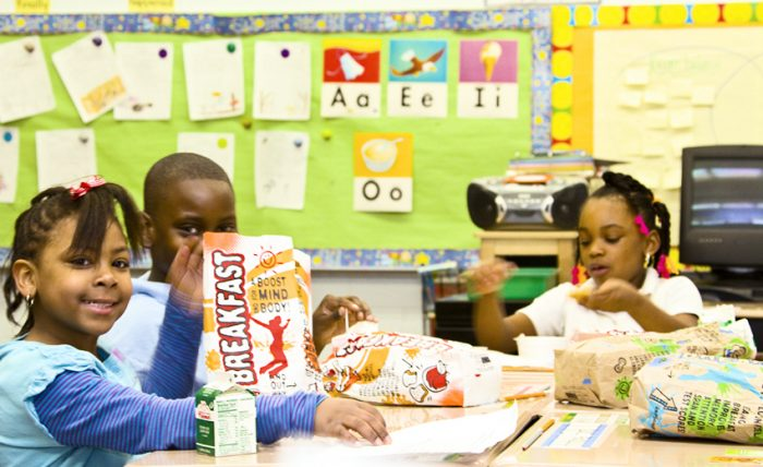 students eating breakfast in the classroom in Chicago Public Schools