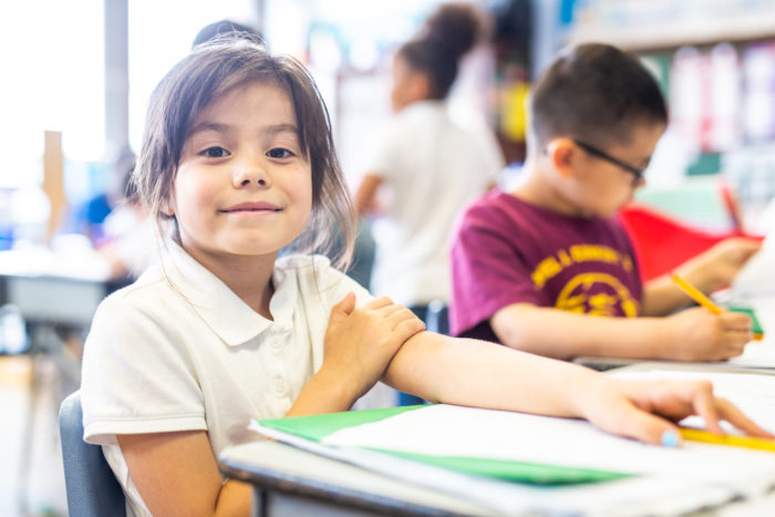 children sitting at school table