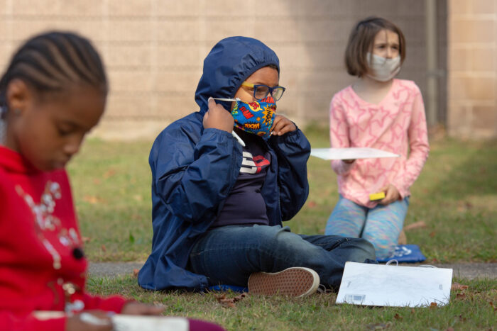 Third-grade students with masks during music class