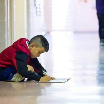 child in school hallway