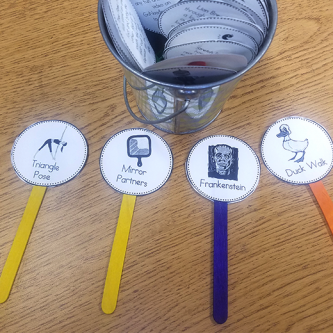 popsicle sticks with activity breaks written on them for physical activity in the classroom