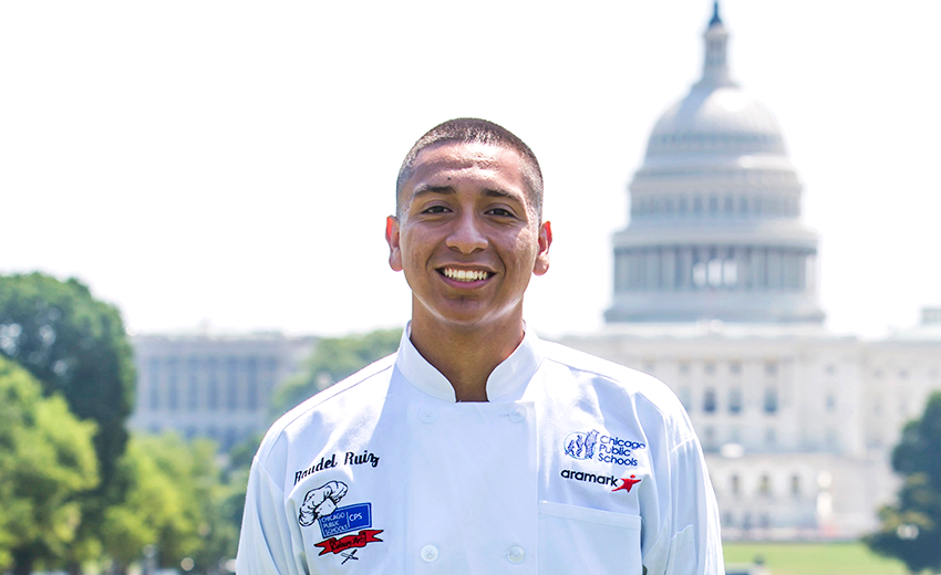 Cooking Up Change Student Chefs Wearing A Chef Jacket With Aramark Logo Standing In Front Of The Washington Monument In Washington, D.C.