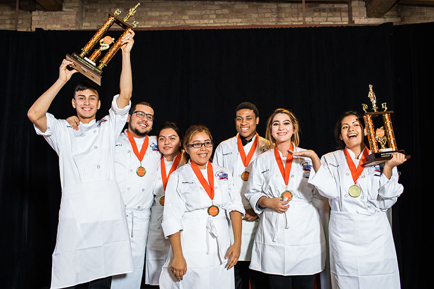 Student chefs from Prosser celebrating with trophies after winning Cooking up Change 2017