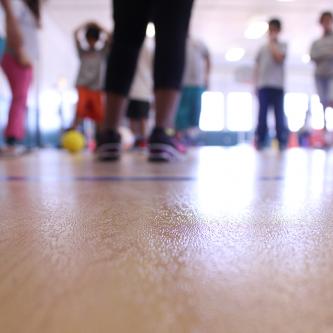 student feet in a school gymnasium