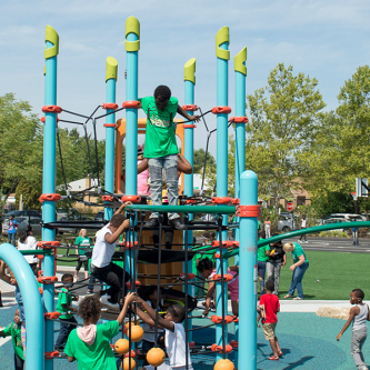 children playing on new playground equipment at the Space to Grow schoolyard at Field Elementary school in Chicago
