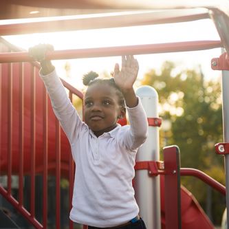 young African American students swinging on Space to Grow playground at Cather Elementary School in Chicago